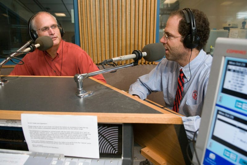 """On Oct. 29, 2007, University of Wisconsin-Madison professors and guest meteorology experts Steve Ackerman (wearing red shirt) and Jonathan Martin (wearing striped tie), also known as """"The Weather Guys,"""" talk about climate and weather science during Wisconsin Public Radio (WPR)'s call-in show """"Conversations with Larry Meiller."""" The program is broadcast from the WPR studios in Vilas Communication Hall at UW-Madison. Ackerman is director of the Cooperative Institute for Meteorological Satellite Studies, and Martin is chair of the atmospheric and oceanic sciences department."""
