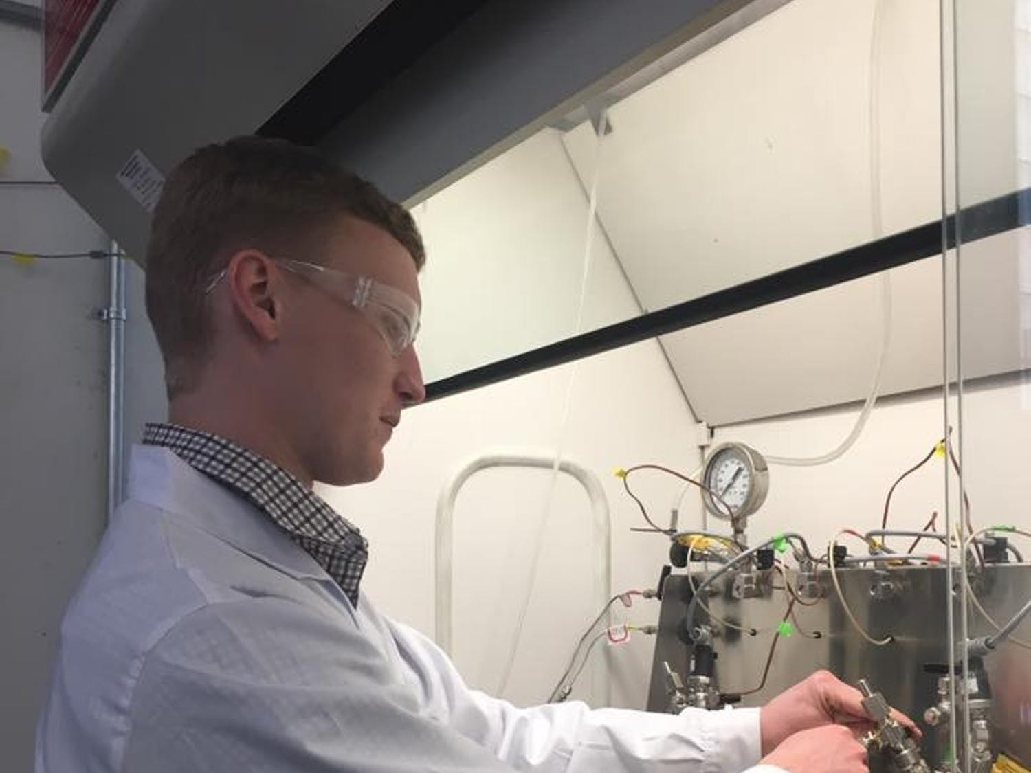 Kevin Barnett works in a lab at the department of energy bioenergy technologies office at UW-Madison to better the procedure for deriving 1,5-pentanediol, a possible substitute for a petroleum-like chemical.
