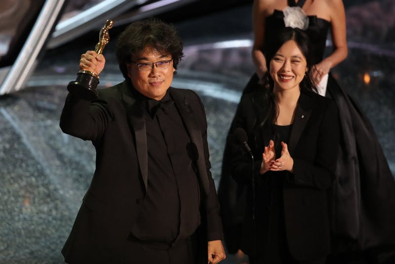Bong John Ho and his interpreter accept one of the four awards he took home.
