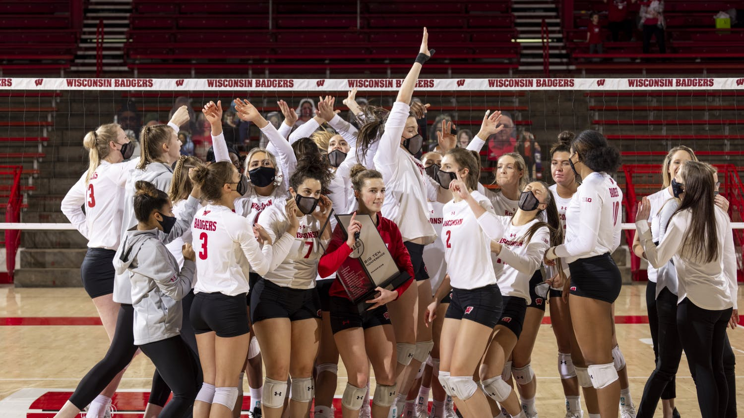 Photo of the Badger volleyball team celebrating their Big 10 championship.