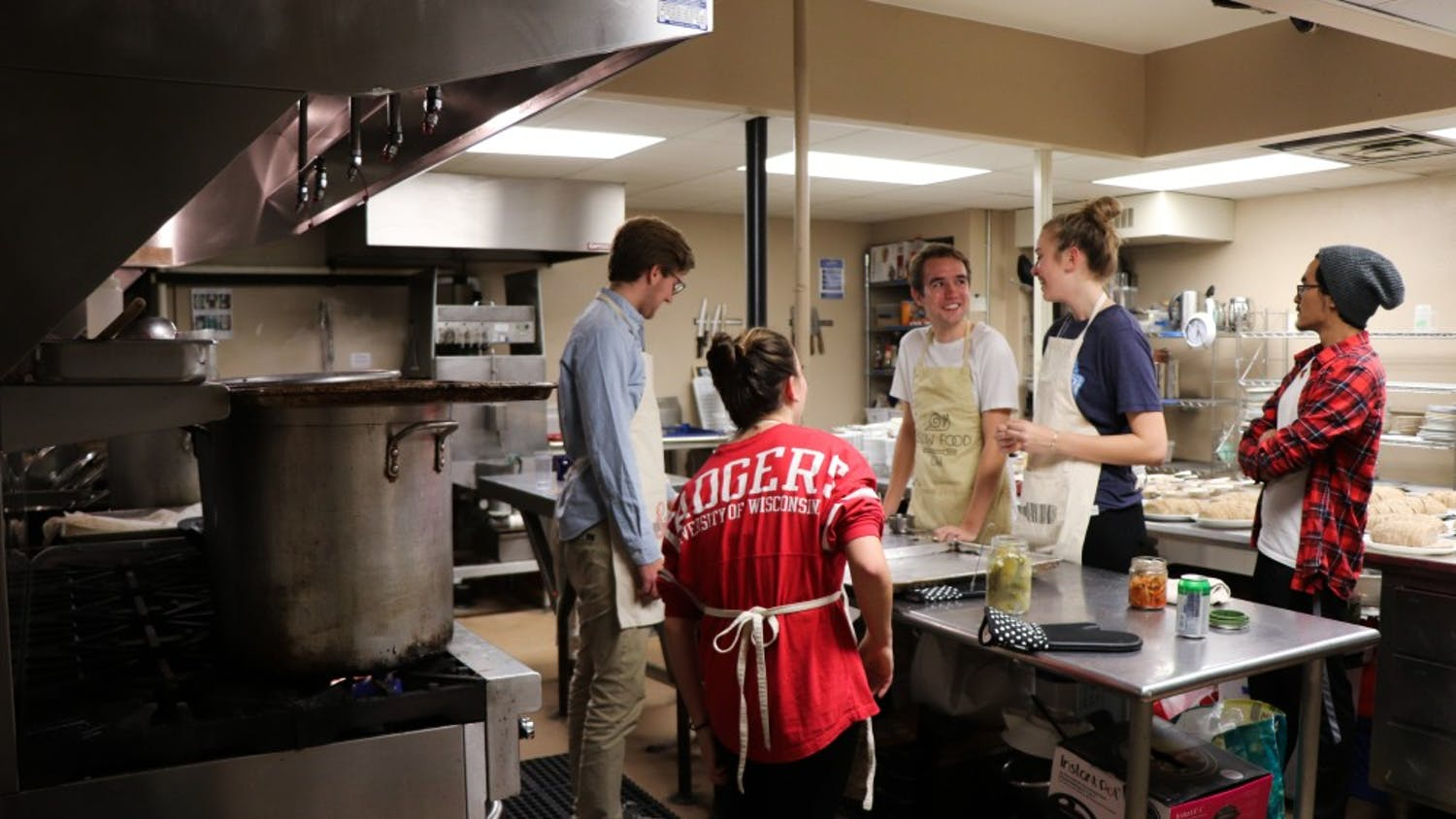 Slow food volunteers prepare a meal in the basement of the crossing. They see themselves as resources,not solutions to food insecurity.