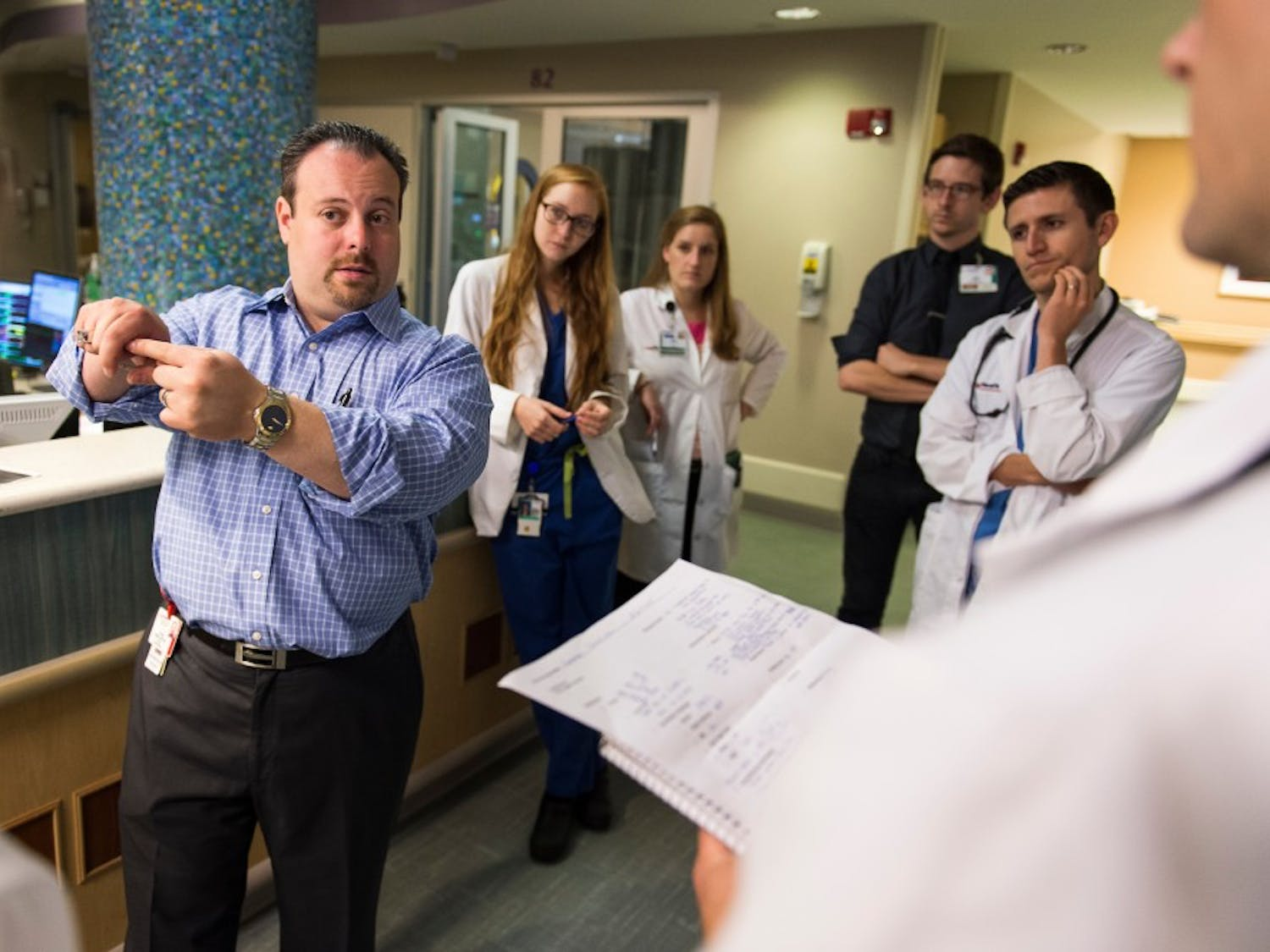 Josh Medow, left, medical director of the Neurocritical Intensive Care Unit at UW Hospital and Clinics, discusses a patient