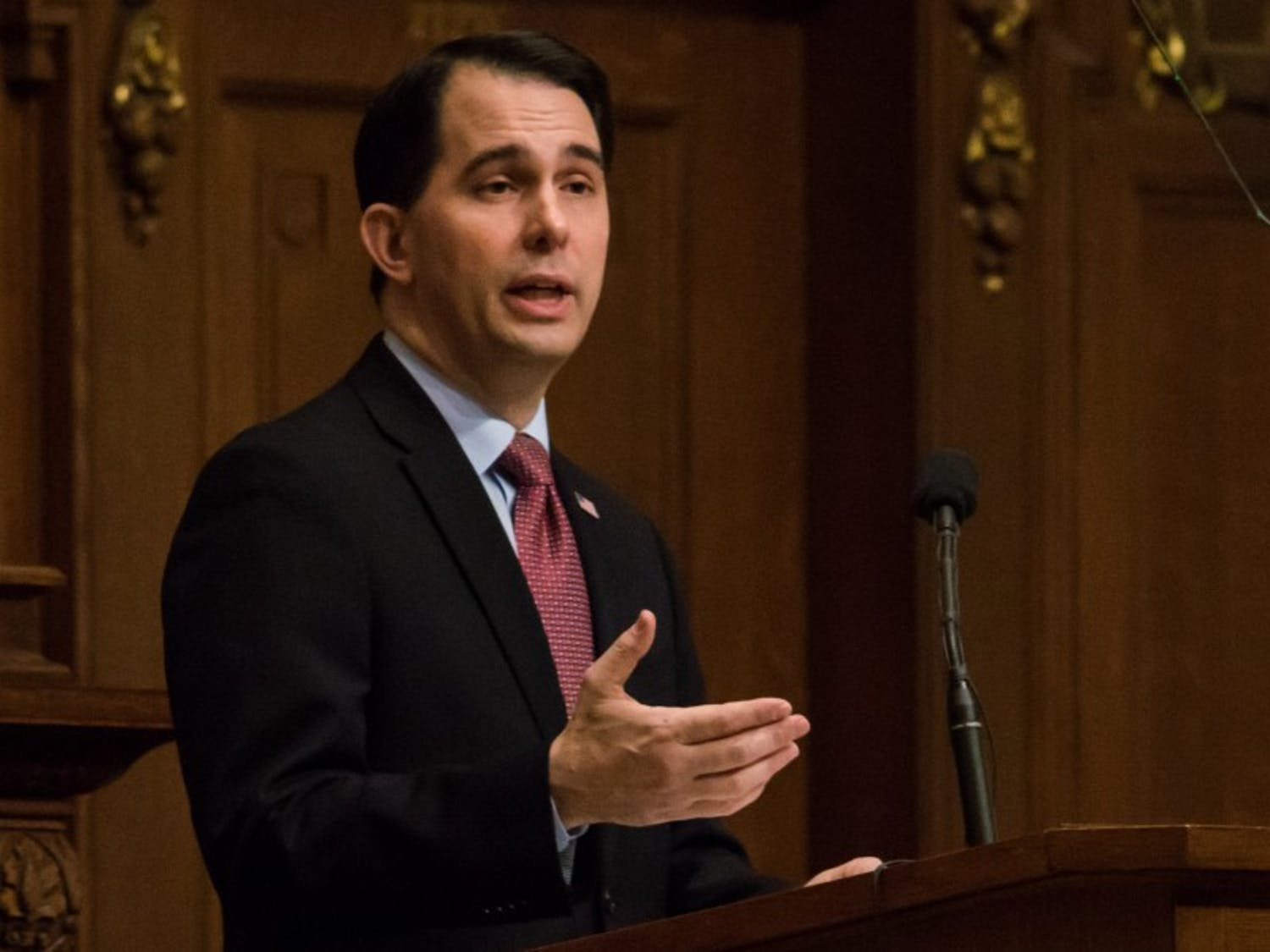 Gov. Scott Walker signed four bills Monday that he says will help make college more affordable for Wisconsinites.