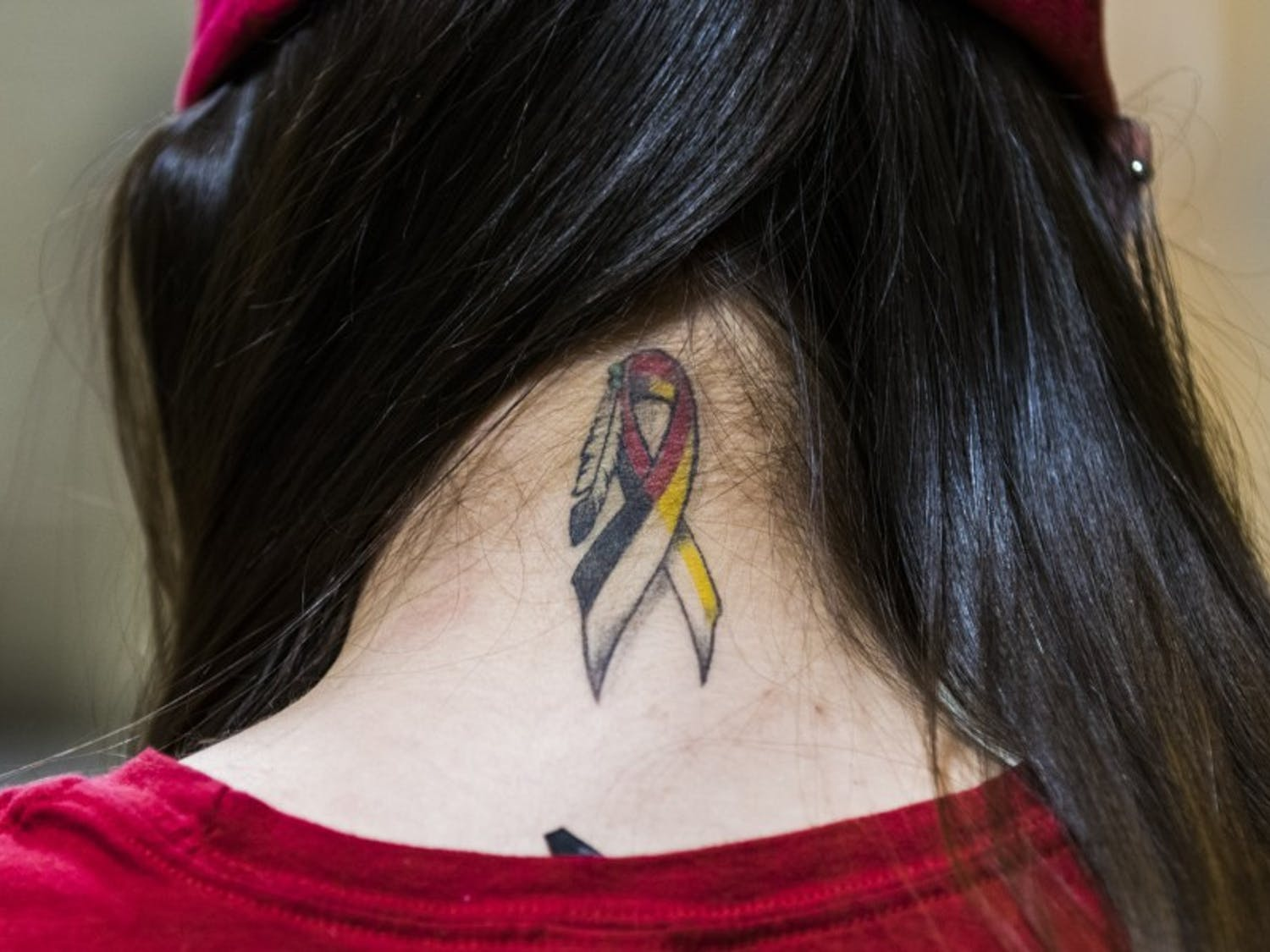 Mariah Skenandore has a tattoo on the back of her neck for missing and indigenous women, an issue surround the disproportionate amount of violence indigenous women face.
