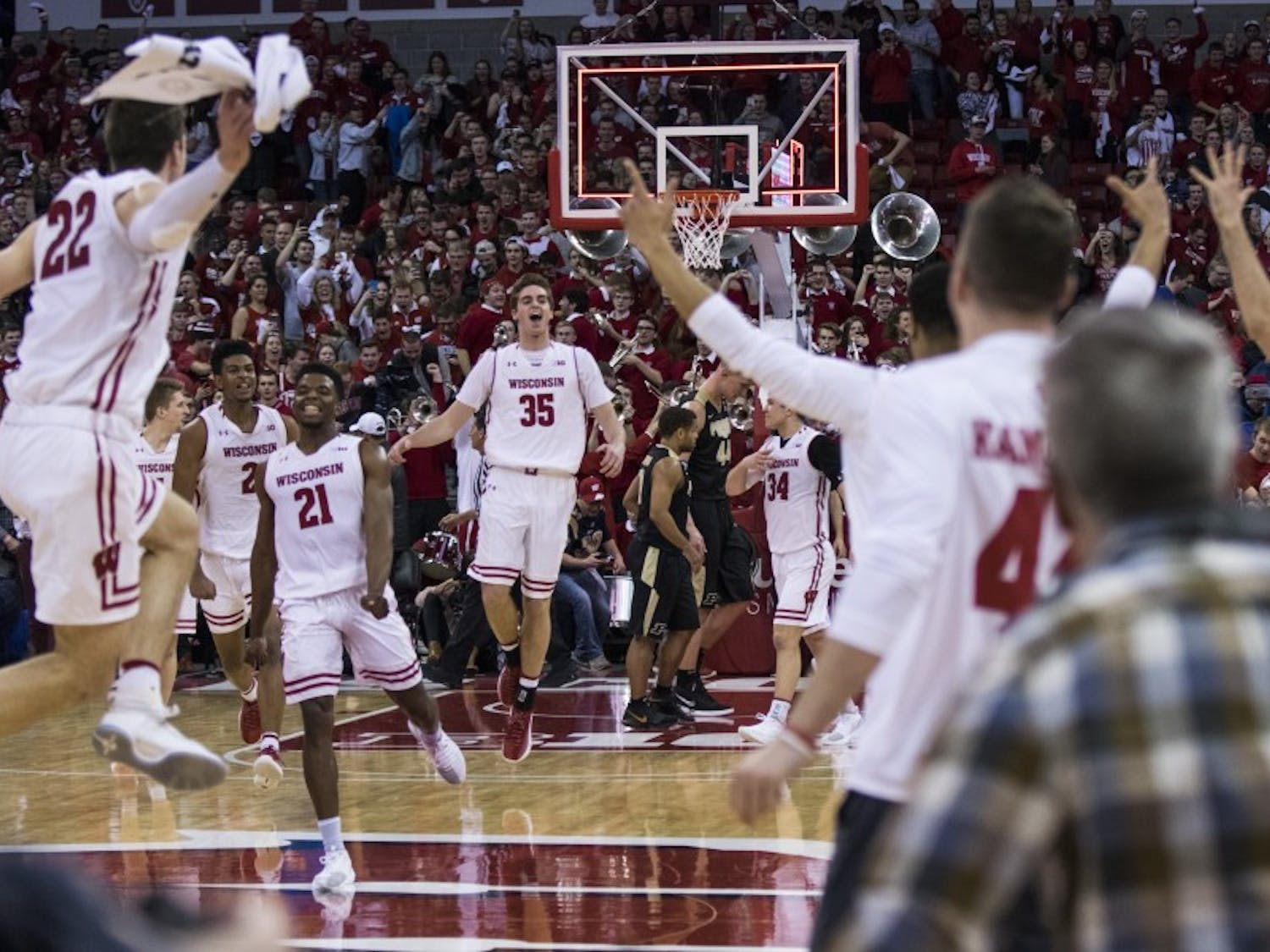 With numerous former players in attendance for the retirement of Frank Kaminsky's number 44,Wisconsin's men's basketball team upset No. 6 Purdue 57-53in a game that came down to the wire.