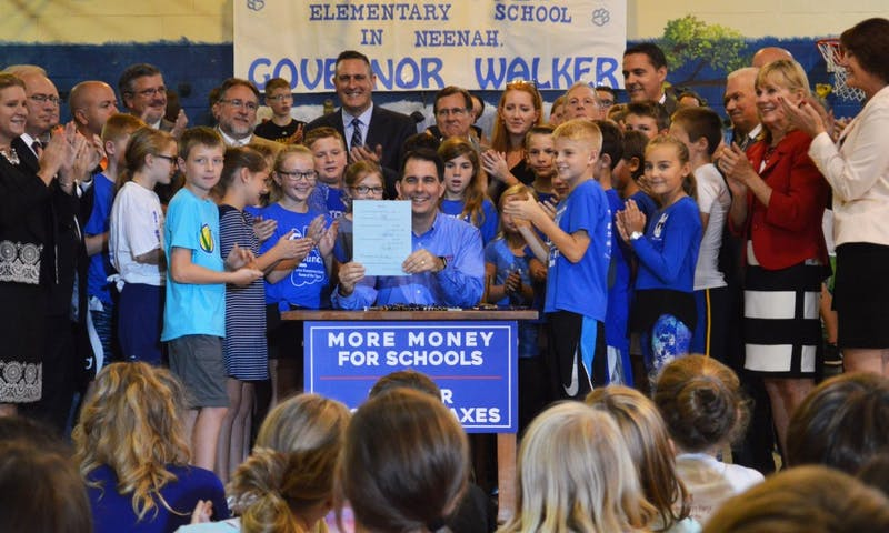 Gov. Scott Walker officially signed the 2017-'19 budget into effect Thursday at Tullar Elementary School in Neenah.