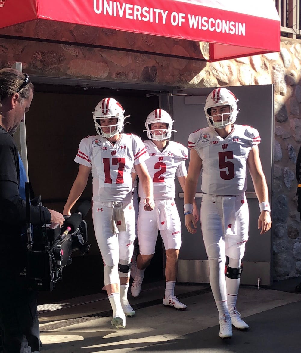 <p>Wisconsin's quarterback room. Left to right: Jack Coan, Chase Wolf, and Graham Mertz.</p>
