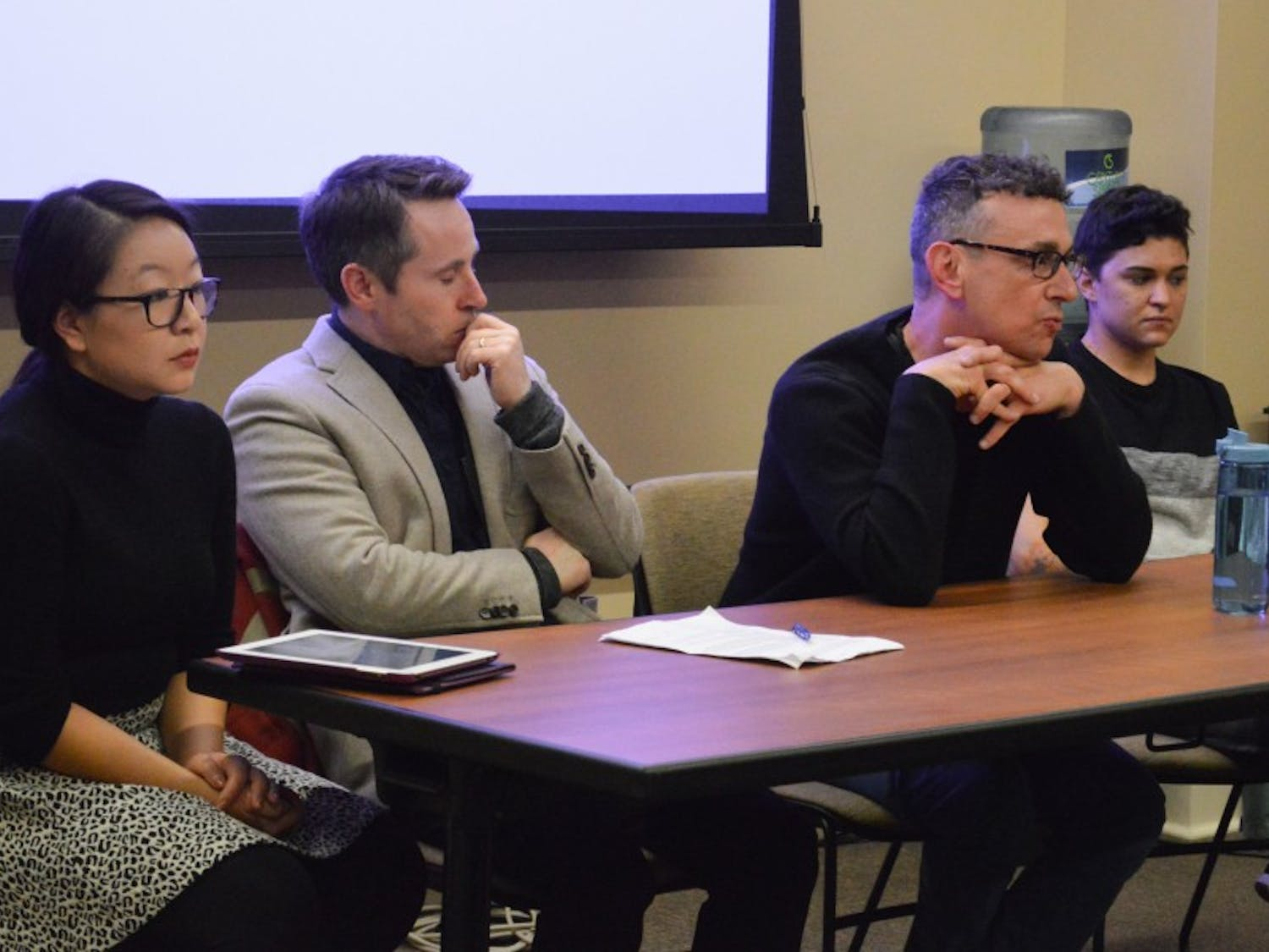 Graduate students Wendy Li andCV Vitolo-Haddad, along withprofessors Don Moynihan and Robert Asen, spoke as part of a panel discussion about the grad student tax increase Wednesday.