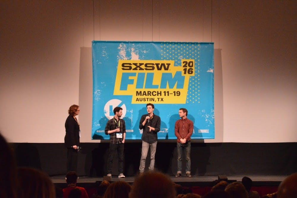 Elijah Wood talks with first-time directors after the screening of their film 'The Trust.'