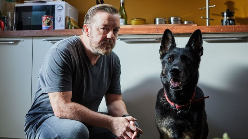 """Gervais' character, Tony, with his dog, Brandy, from Netflix's new hit show """"After Life."""" It was released for streaming on March 8."""