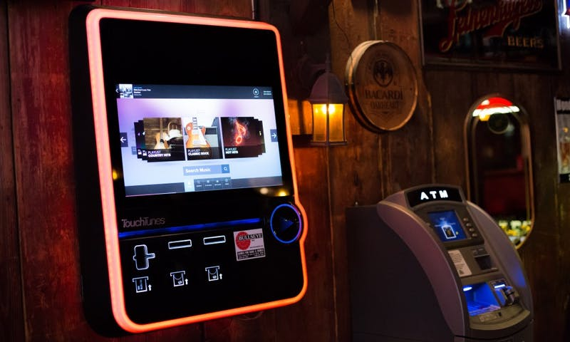 TouchTunes jukeboxes allow users to choose from thousands of songs, but hip-hop artists are unavailable on some in campus-area bars.