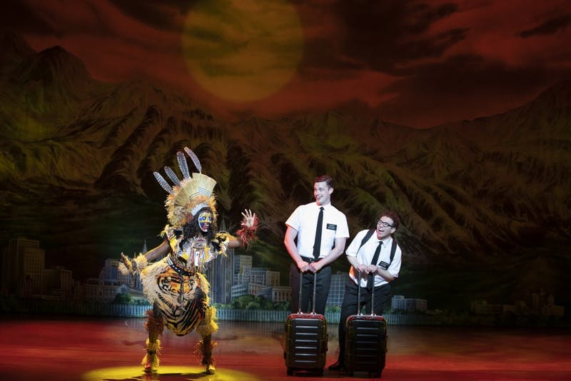 """""""The Book of Mormon"""" fails to evolve, persisting racism in a controversial political climate. Is it time to pull the curtain?"""
