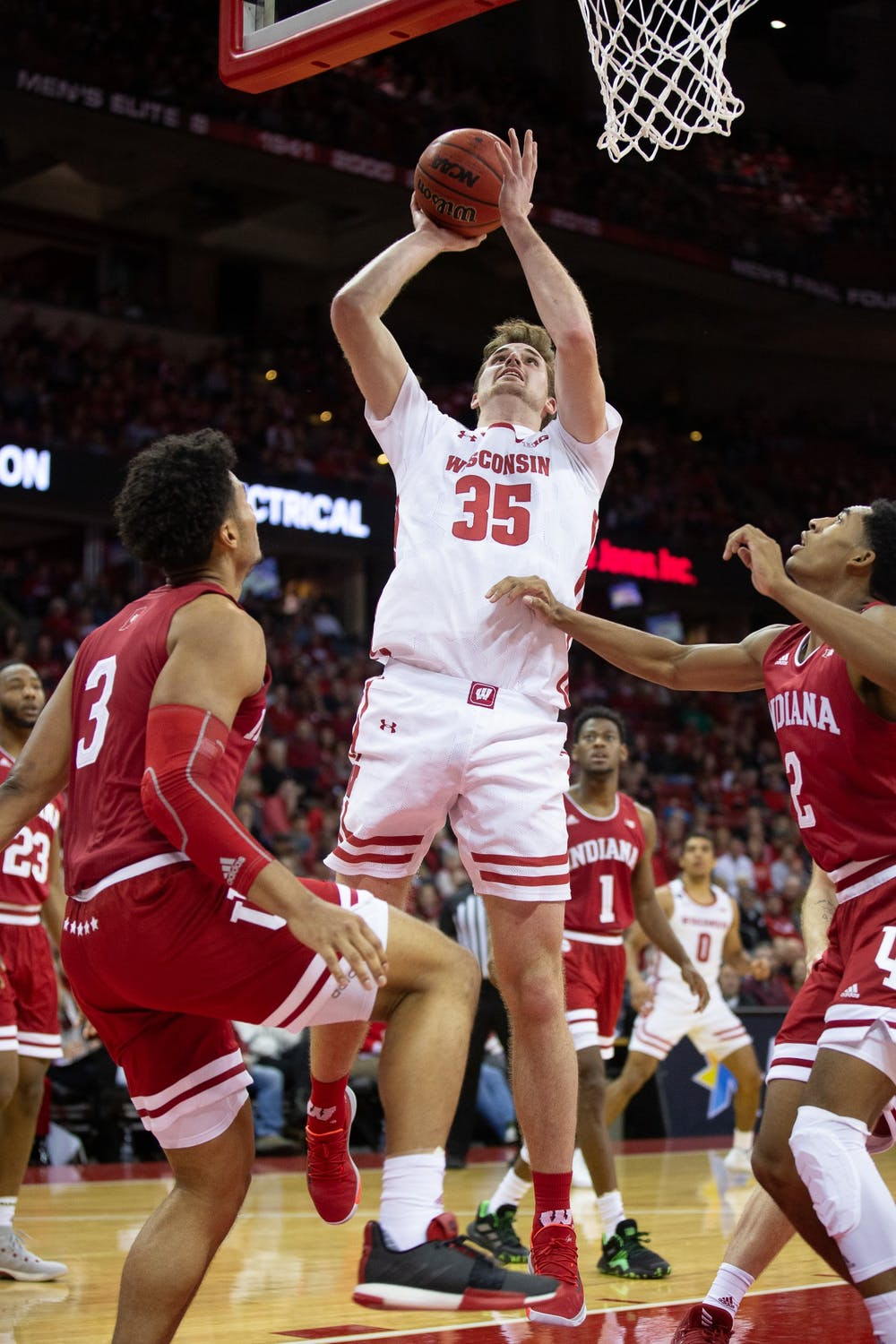 <p>Nate Reuvers' late offensive rebound and basket helped clinch UW's 60-56 win over Indiana.&nbsp;</p>