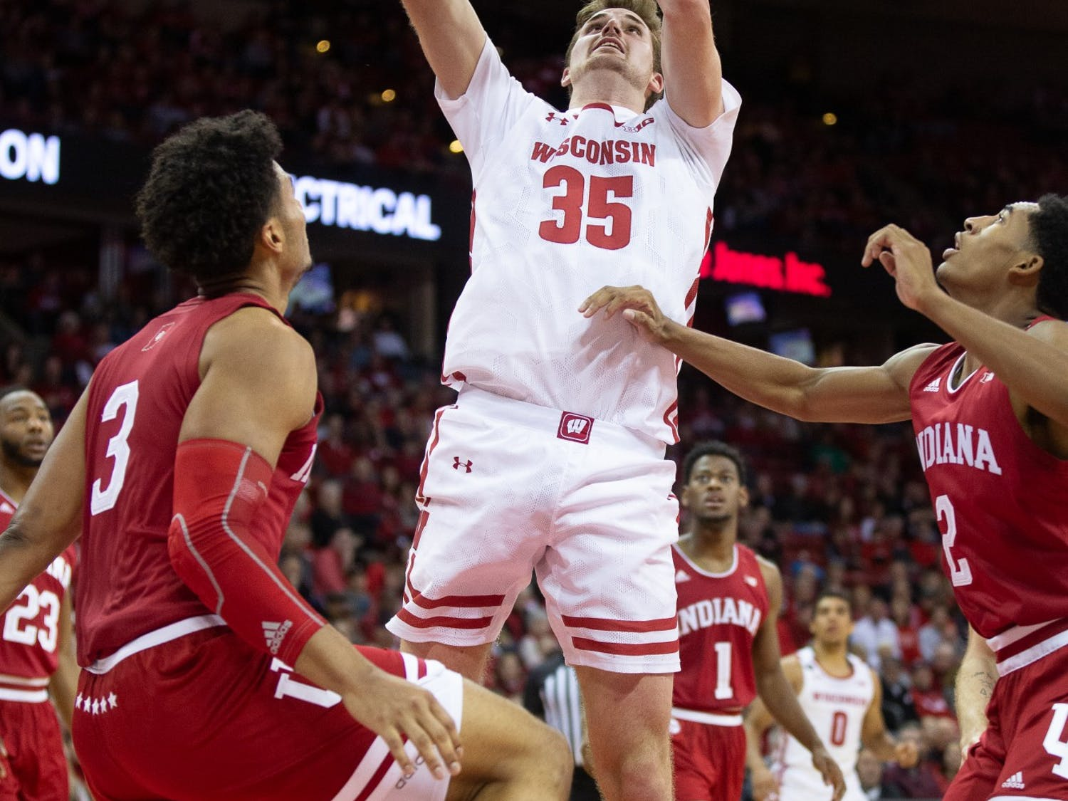 Nate Reuvers' late offensive rebound and basket helped clinch UW's 60-56 win over Indiana.