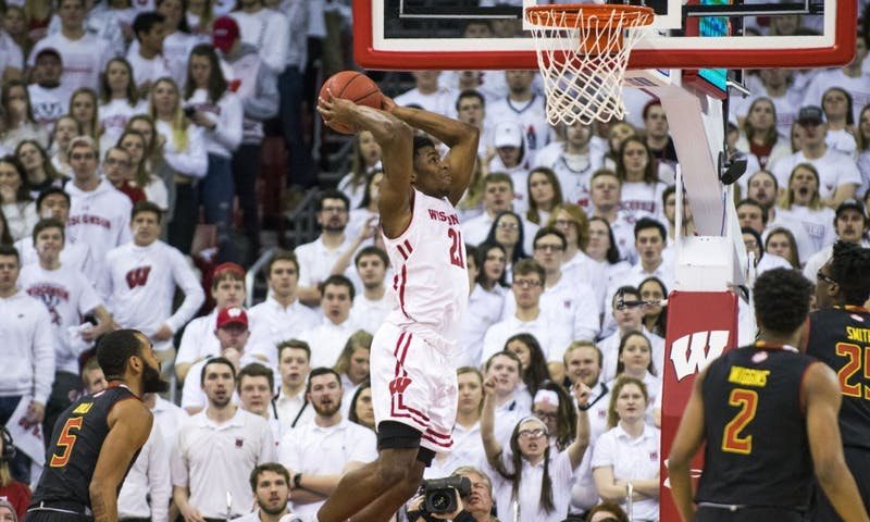 Senior guard Khalil Iverson posted career highs with 24 points and 15 rebounds to lead Wisconsin to a Big Ten tournament double-bye.