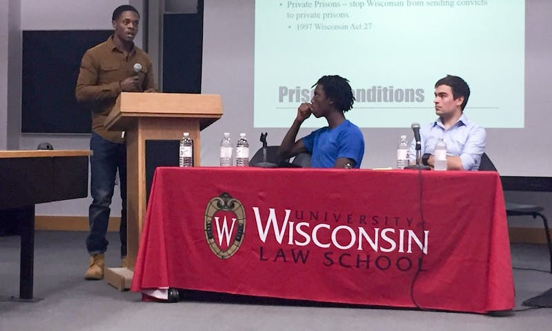 Reggie Thedford discussed the importance of community awareness of prison conditions while fellow panelists Tyriek Mack and Michael Roy look on during a panel on mass incarceration at the Law School.