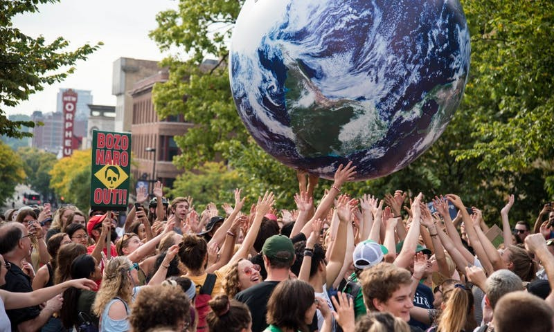 Madisonians join worldwide movement to advocate for global climate reform.