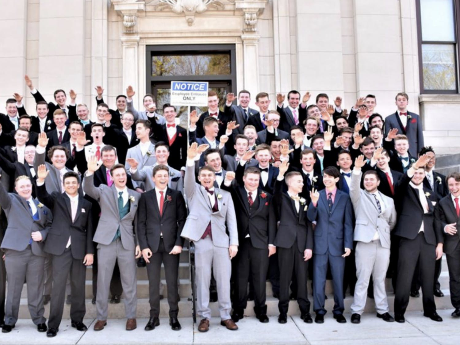The Baraboo School District is investigating a photo posted to Twitter Sunday night showing dozens of Baraboo High School students giving a Nazi salute on the steps of the Sauk County Courthouse.