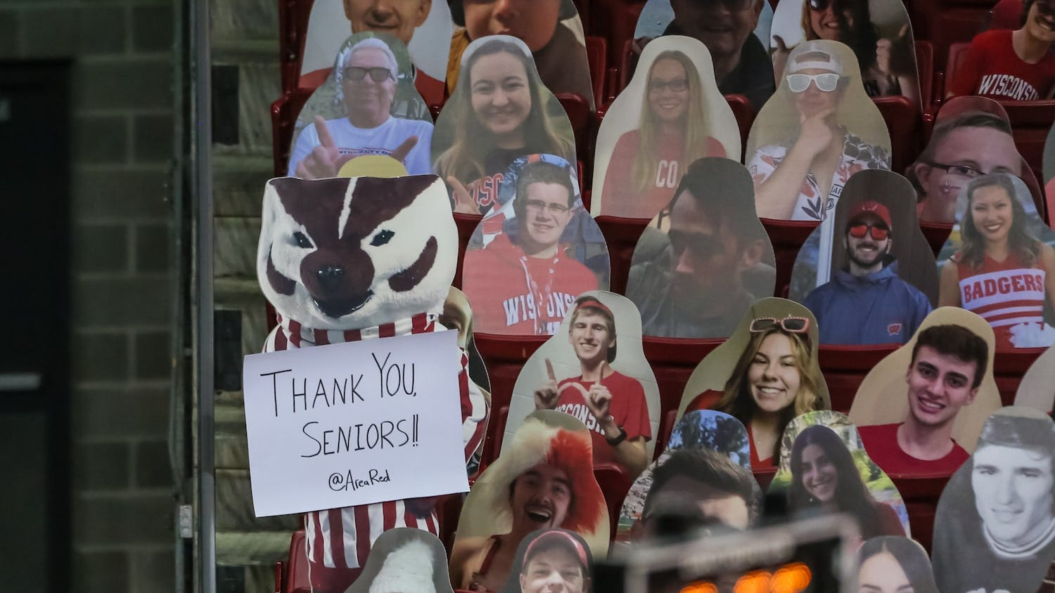 Cardboard cutouts of fans fill the Kohl Center.