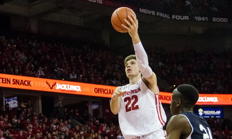 Senior forward Ethan Happ scored his 2000th career point with six minutes left Tuesday night, but the Badgers couldn't find any other offense down the stretch in a loss.