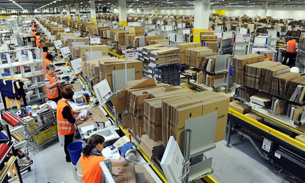 Photo of workers in an Amazon warehouse.
