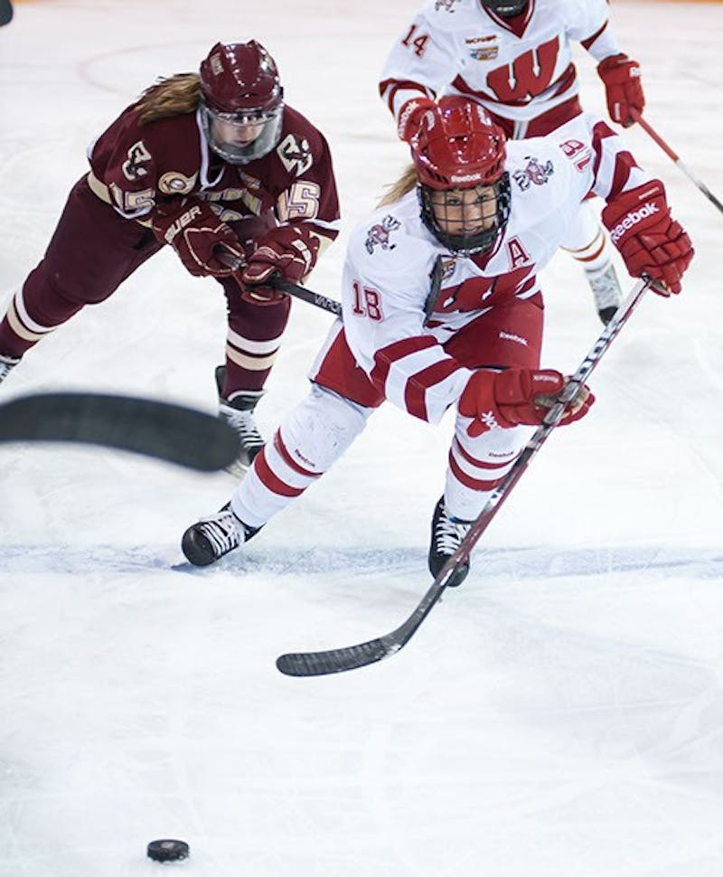 Wisconsin's assistant captain Brianna Decker (18), a finalist for the NCAA's Patty Kazmaier Memorial Award for player of the year, took 10 of the Badgers 38 shots for the night, coming up empty each time but maintaining pressure on the Golden Eagle's defense.