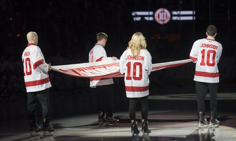 Wisconsin retired the No. 10 jersey of Badger legend Mark Johnson on Saturday night, the first retired jersey in program history.