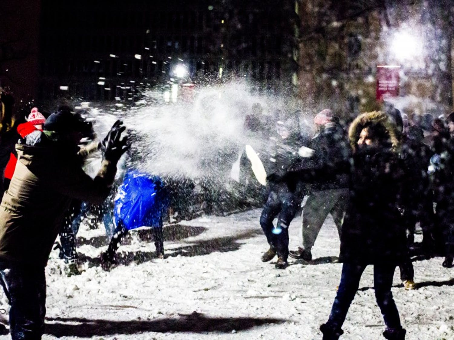 Current and former residents of the Lakeshore and Southeast neighborhoods faced off on Bascom Hill in the annual Battle for Bascom snowball fight.
