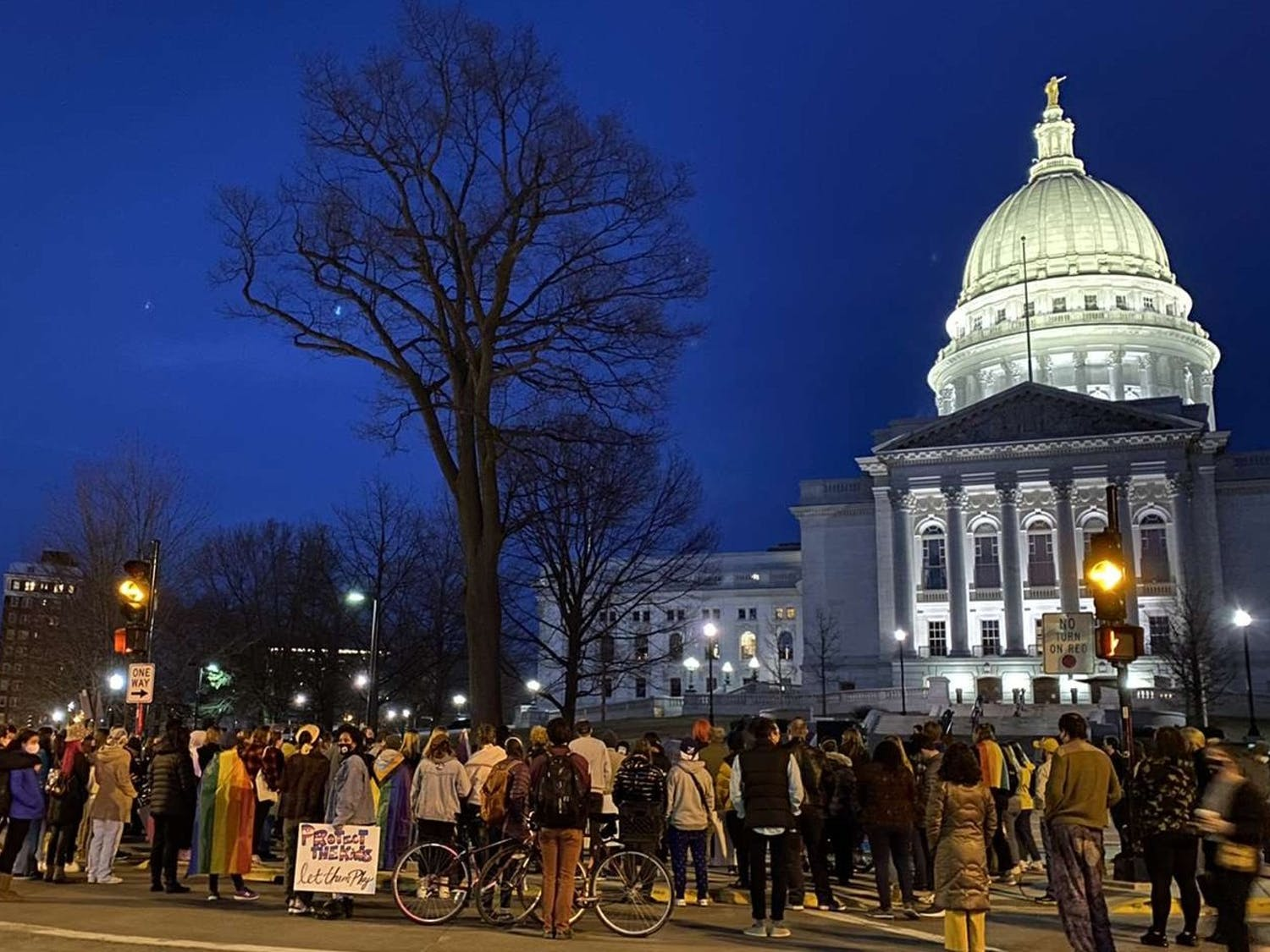 Photo of a protest in front of the Wisconsin State Capitol in support of trans athletes.