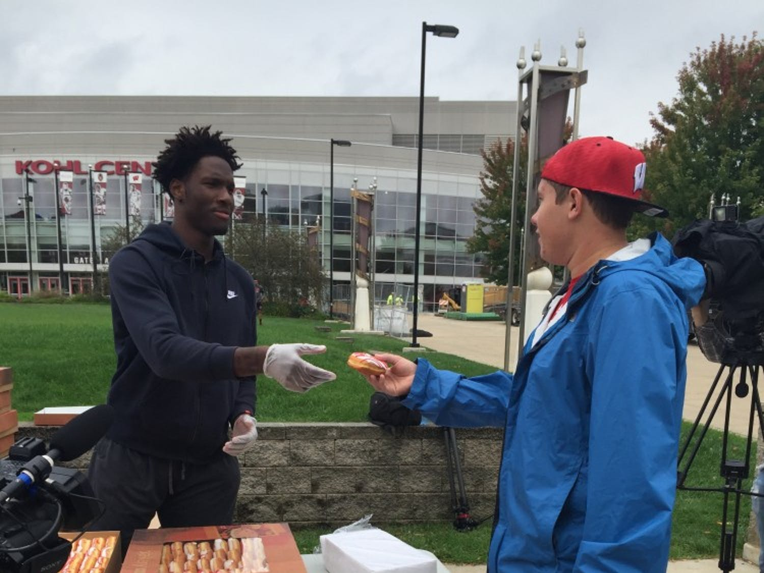 Nigel Hayes handingout the first of many doughnuts Friday.