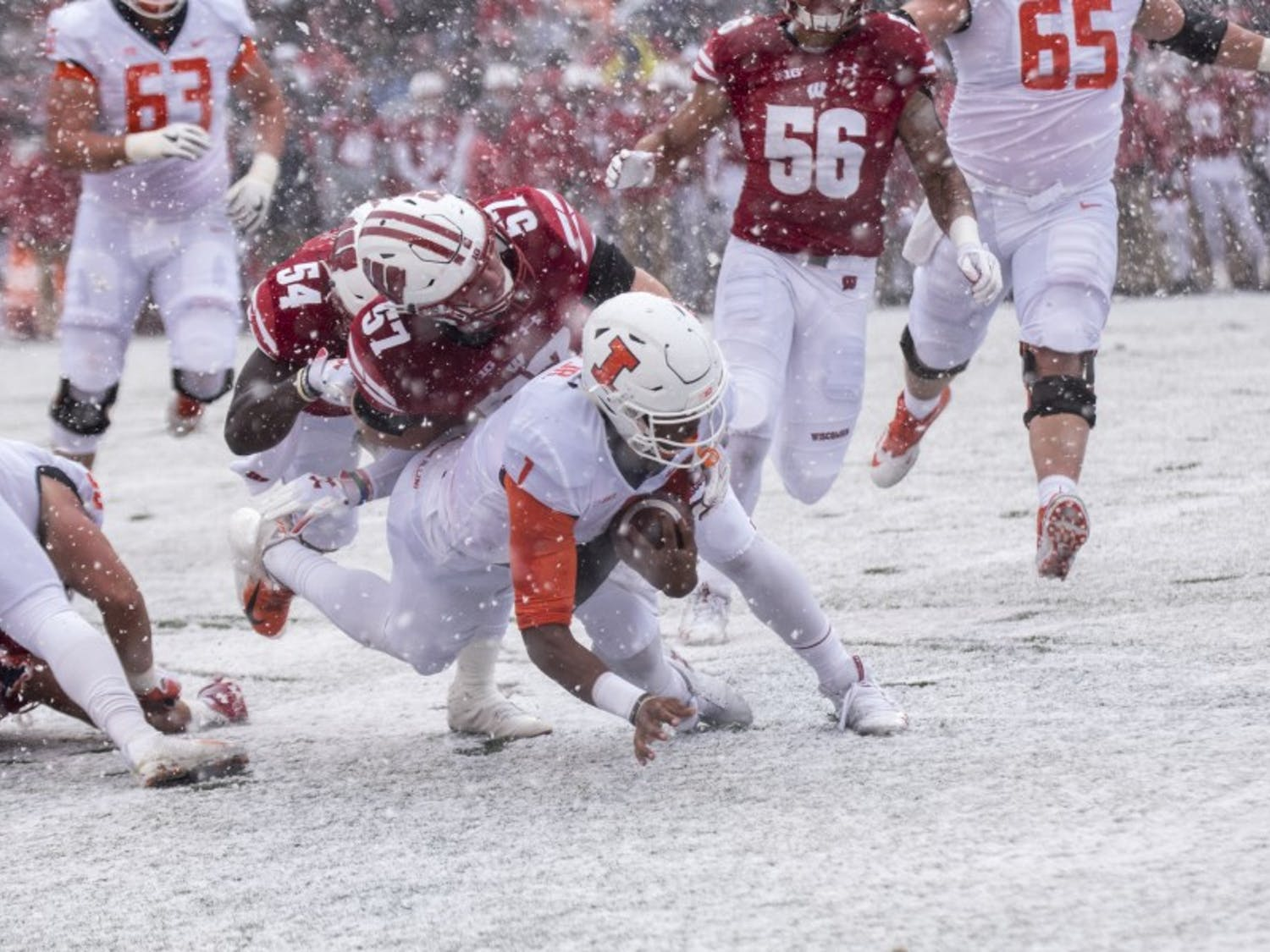 Wisconsin's defense took advantage of a sudden snowstorm late in the first quarter to collect three interceptions and a pair of fumbles in the first half.