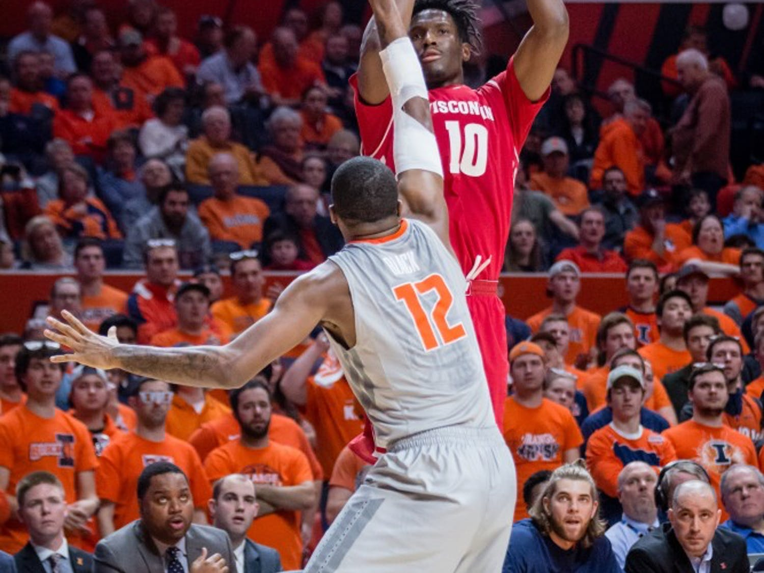 Wisconsin's Nigel Hayes (10) shoots a three over Illinois' Leron Black (12) during the game at State Farm Center on Tuesday, January 31.