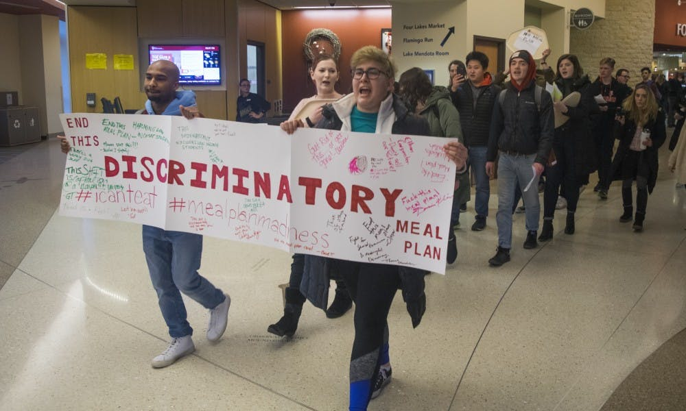 Students marched through Four Lakes Market Tuesday to voice their opposition against UW-Madison's meal plan for incoming freshmen.