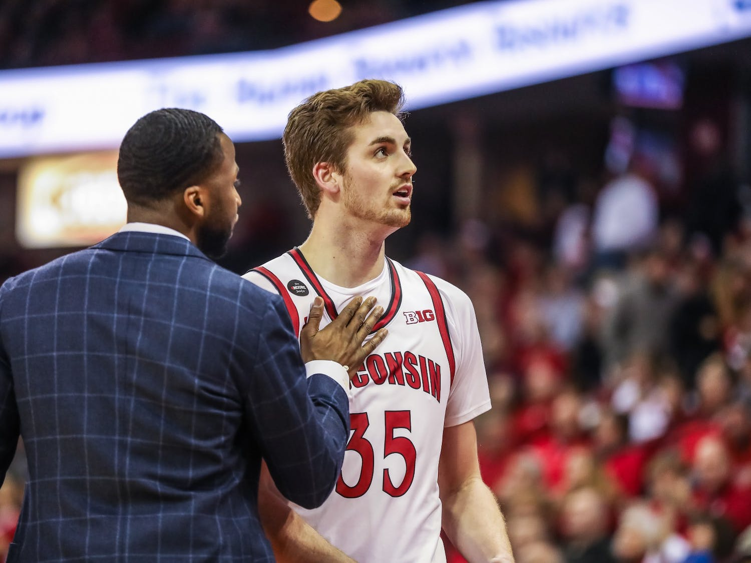 Nate Reuvers has led the Badgers in scoring through three games, averaging 15 points, five rebounds and nearly three blocks a game