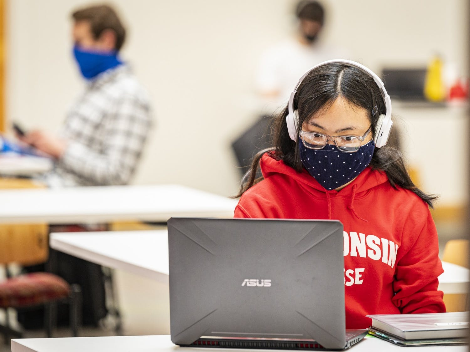 A student wears a mask as part of the Safer Badgers protocol while studying inside of Engineering Hall.