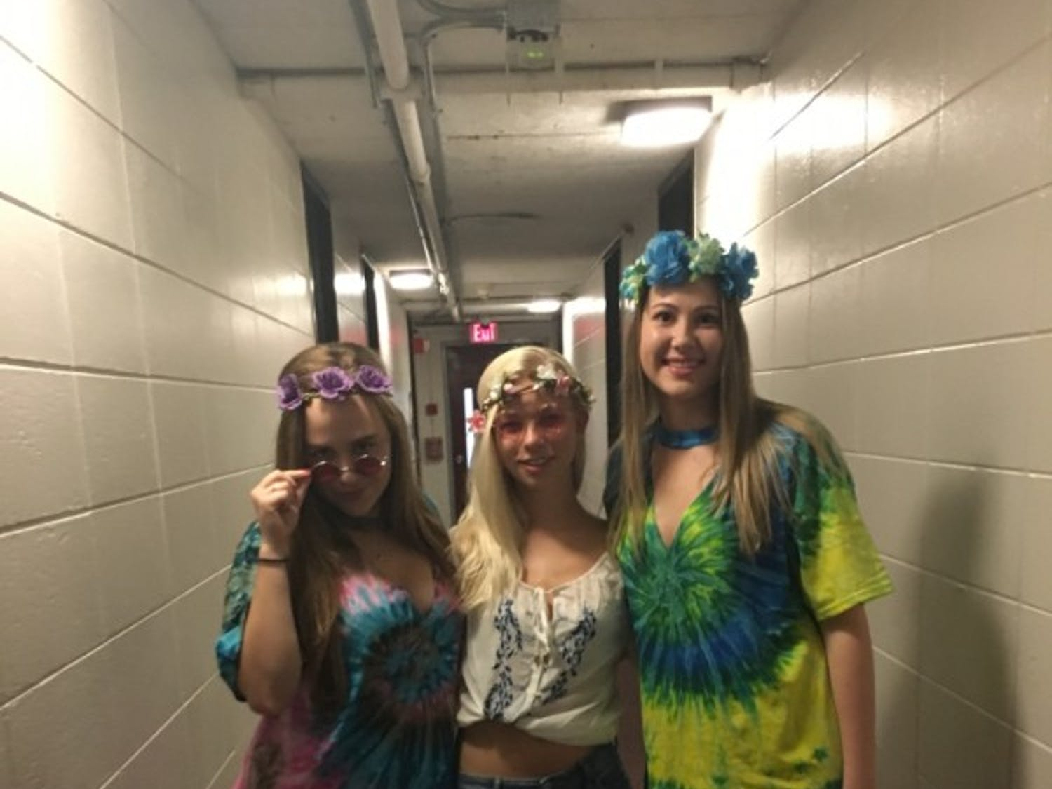 Three students show off their homemade hippie costumes.
