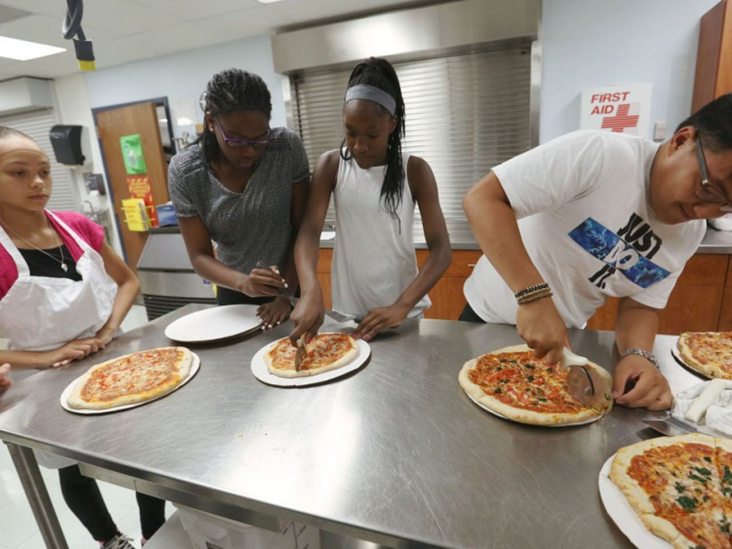 UW-Madison fifth-year student Donale Richards instructed a science curriculum for high school juniors and seniors enrolled in the PEOPLE Program during the summer of 2016 and worked with the group to market their own pizza.
