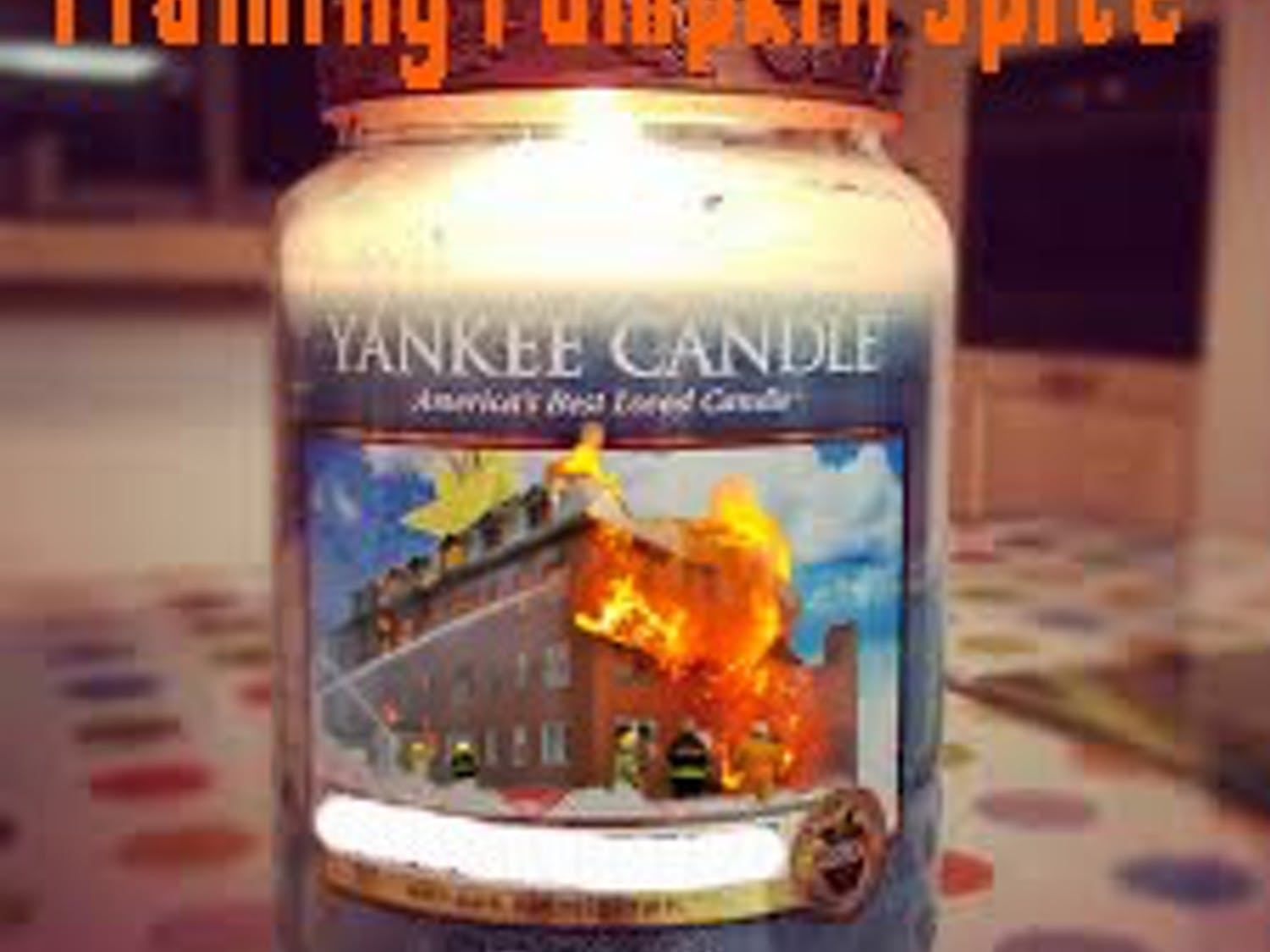 Yankee's new scent features real photos of the fire as it ravaged the factory.