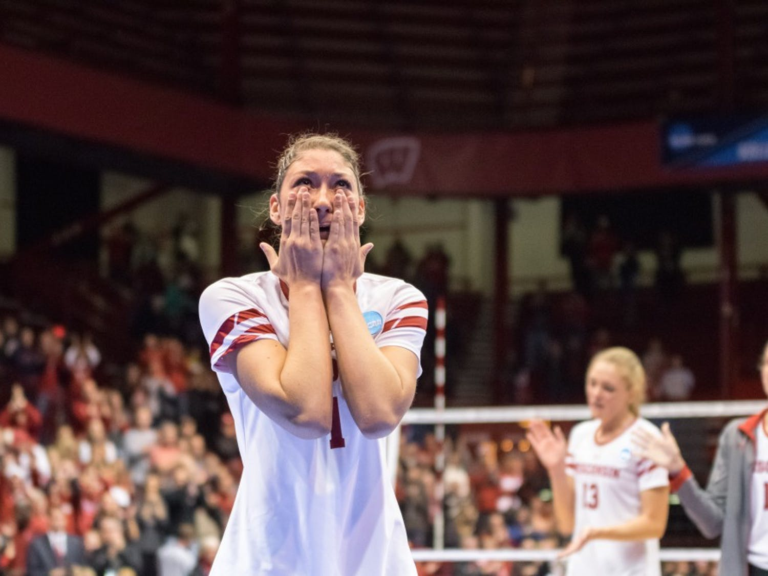 Lauren Carlini wipes tears from her eyes as she says goodbye to a standing ovation from the Wisconsin faithful.