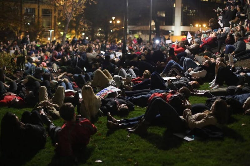 """More than 2,000 students and members of the Madison community engage in a """"die-in"""" at the Capitol steps in solidarity with historically marginalized groups."""