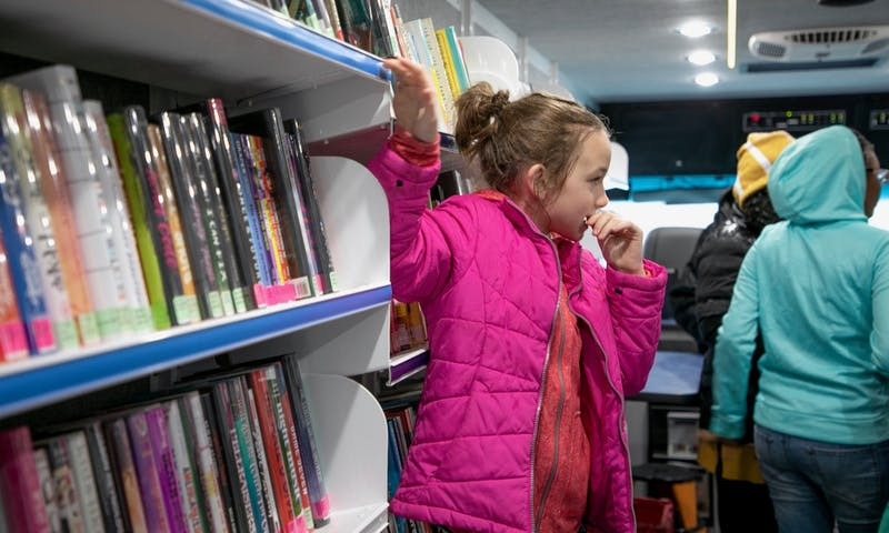 Library on Wheels offers more opportunities for students with limited access to public libraries to check out a book.