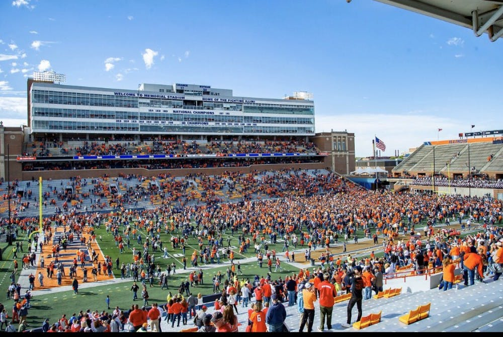 Illinois fans storm the field after pulling off massive upset on homecoming weekend.
