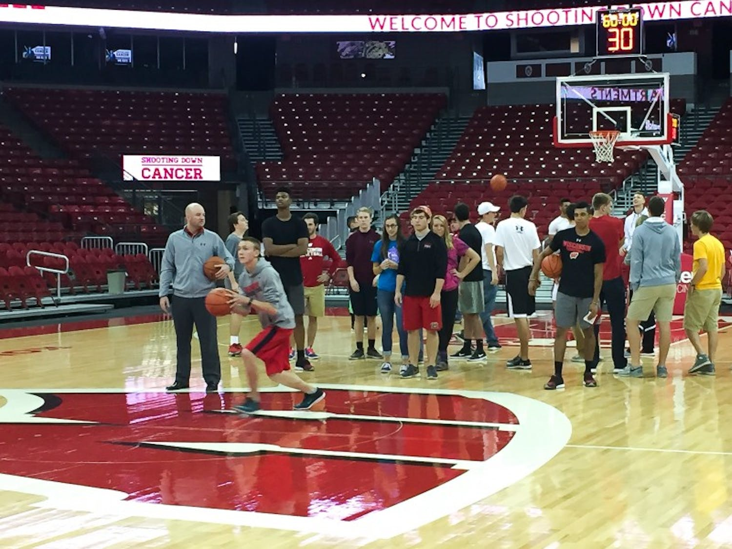 Wisconsin head coach Greg Gard and the rest of UW's men's basketball team teamed up with students to raise more than $20,000 for cancer research Monday afternoon.