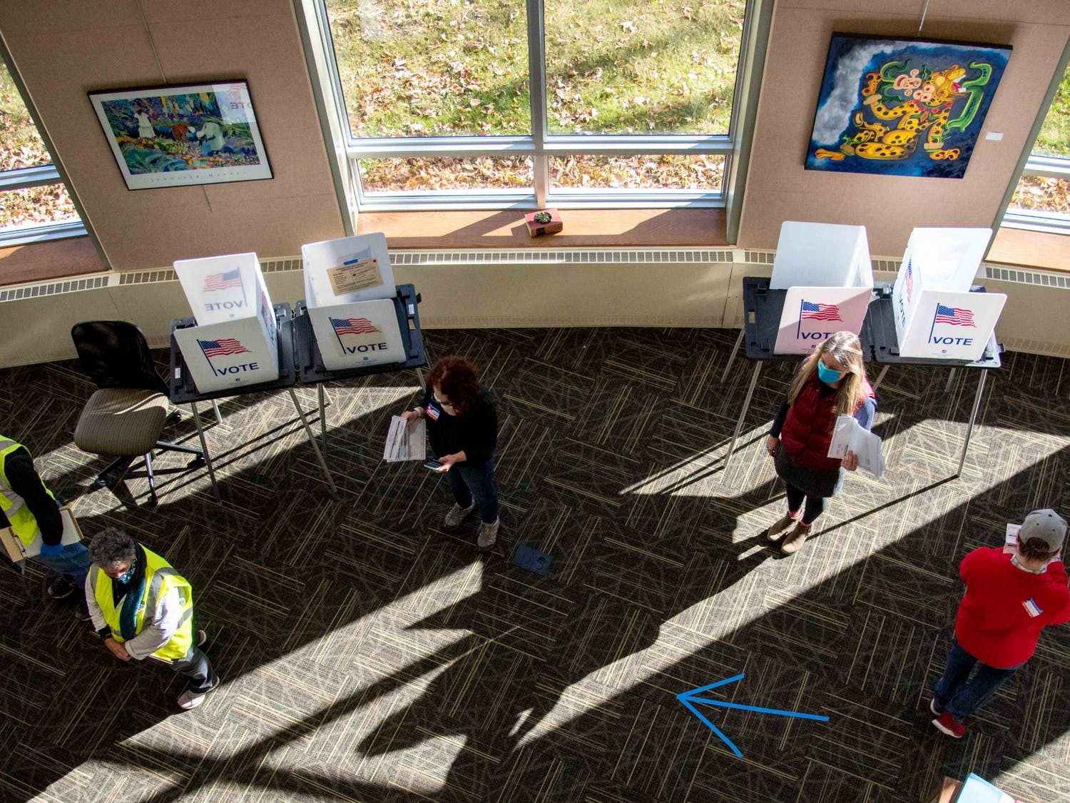 Election officials operate a polling place at the Edgewood College Rennebohm Library in Madison, Wis., on November 3, 2020.