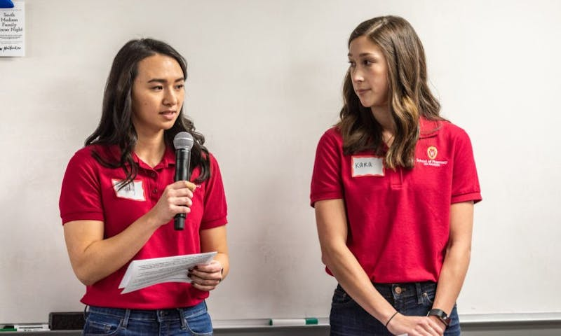 Members of the Phi Lambda Sigma chapter at UW-Madison led discussions aimed to help unpaid Alzheimer caregivers navigate through their responsibilities and maintain their own health.