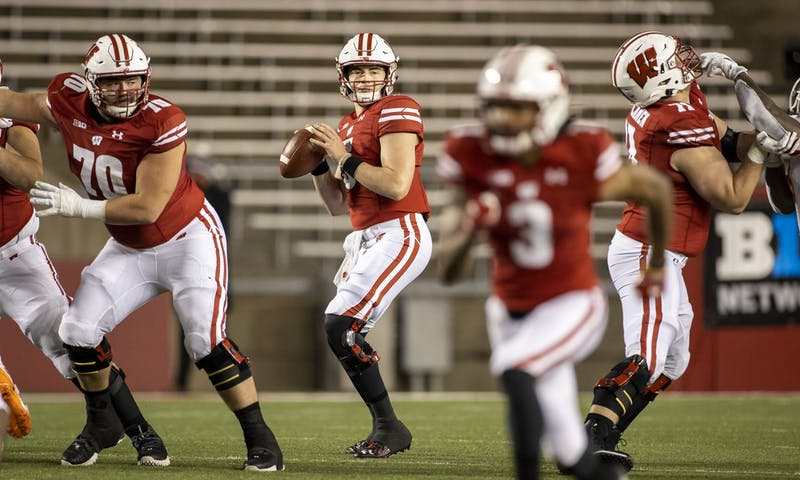 Wisconsin Badgers quarterback Graham Mertz (5) looks for a receiver during an NCAA college football game against the Illinois Fighting Illini Friday, Oct. 23, 2020, in Madison, Wis. The Badgers won 45-7. (Photo by David Stluka/Wisconsin Athletic Communications)