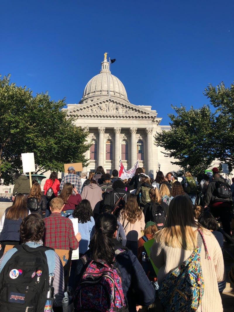 Madison demonstrators protest President Donald Trump's appointment of Brett Kavanaugh to the Supreme Court following sexual assault allegations on Oct. 4, 2018.