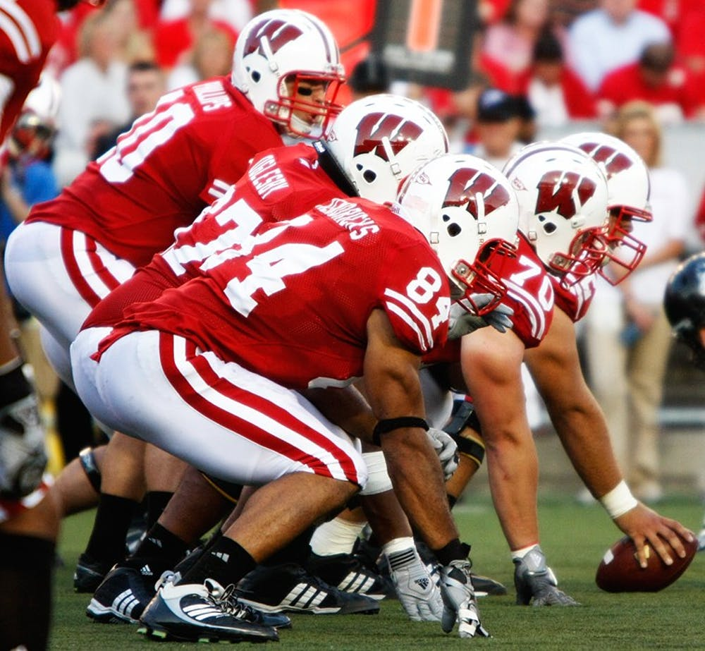 Badgers use new style for same approach