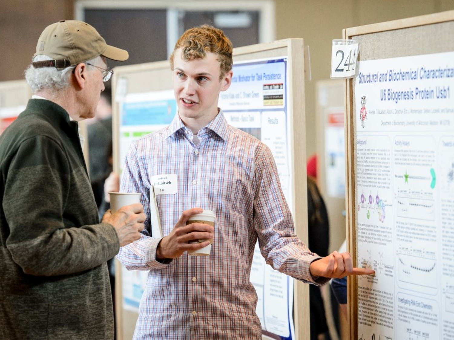 Andrew DeLaitsch presents his research project to attendees at the Undergraduate Symposium hosted in Varsity Hall at Union South at the University of Wisconsin-Madison on April 13, 2017. The annual event showcases student-led research, creative endeavors and service-learning projects. (Photo by Bryce Richter / UW-Madison)