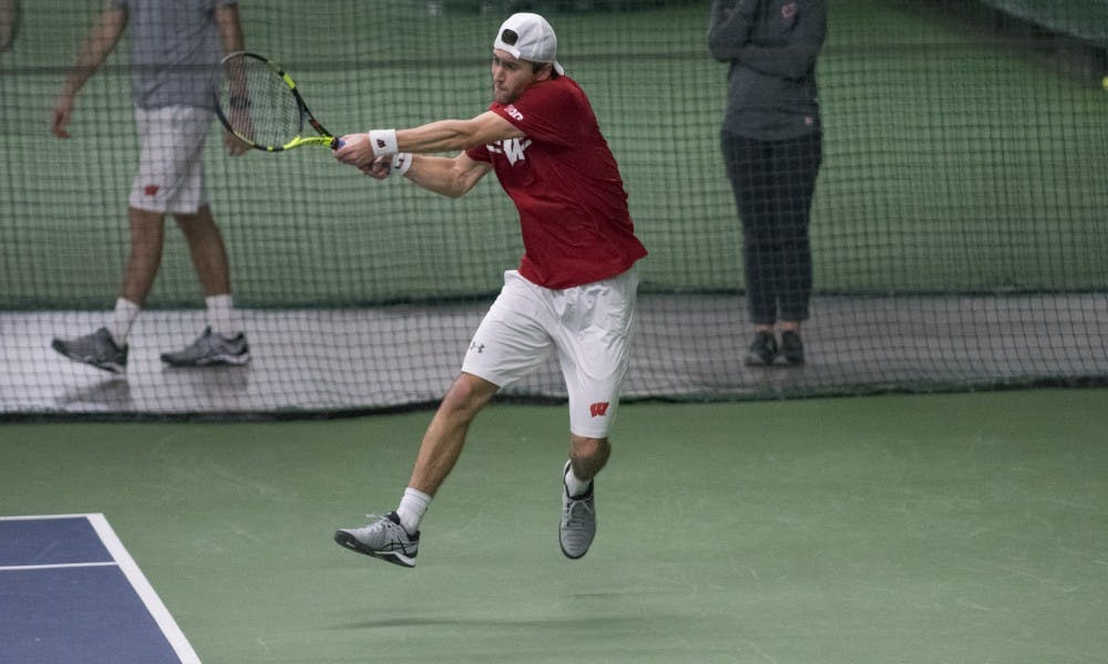 Wisconsin men's tennis split its weekend series with Illinois and Northwestern.